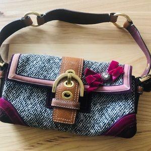 Coach purse with short shoulder strap
